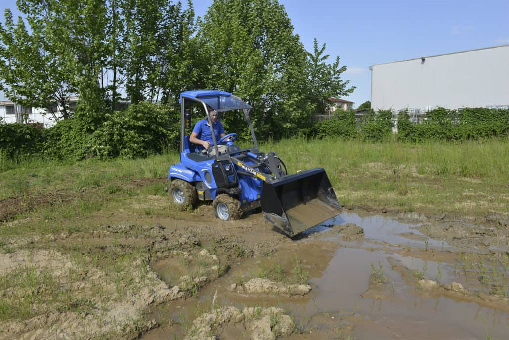 MultiOne-mini-loader-2-series-with-bucket-mud-3-1030x688